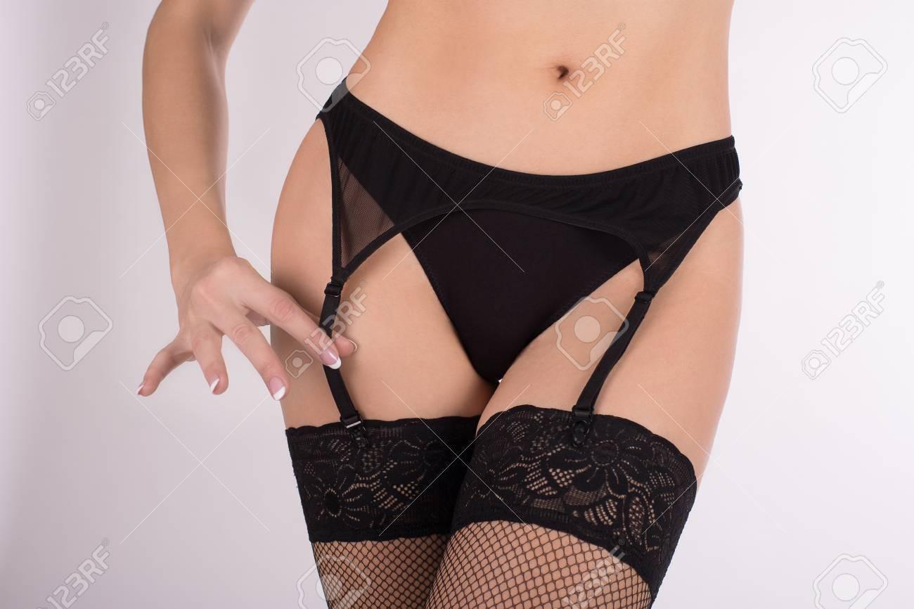e32b0c85048 Female Hips In Black Sexy Garter Belt