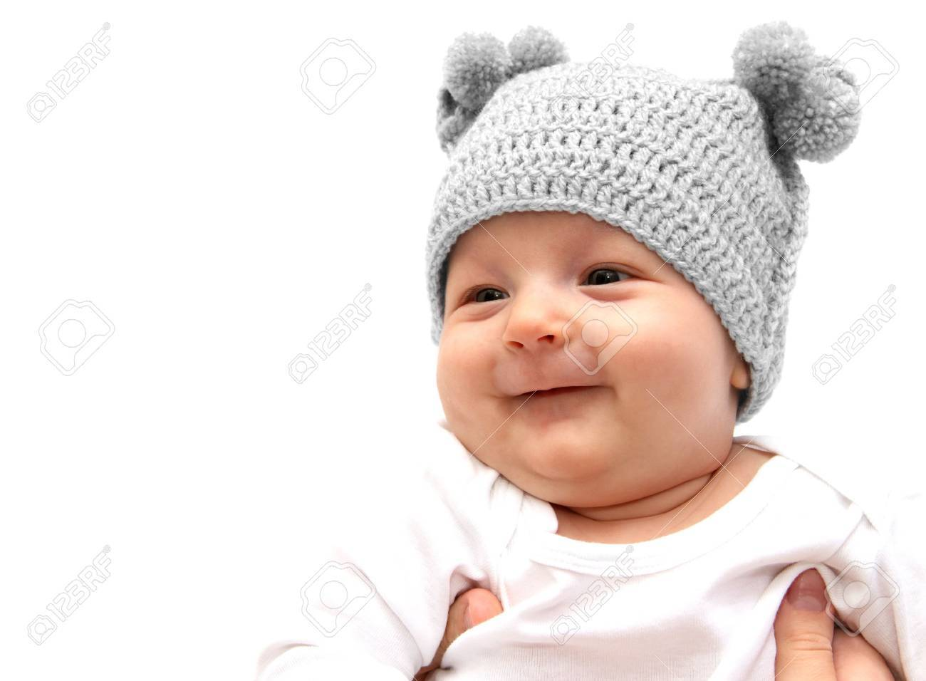 Happy baby in knitted hat in mothers hands Stock Photo - 18008655