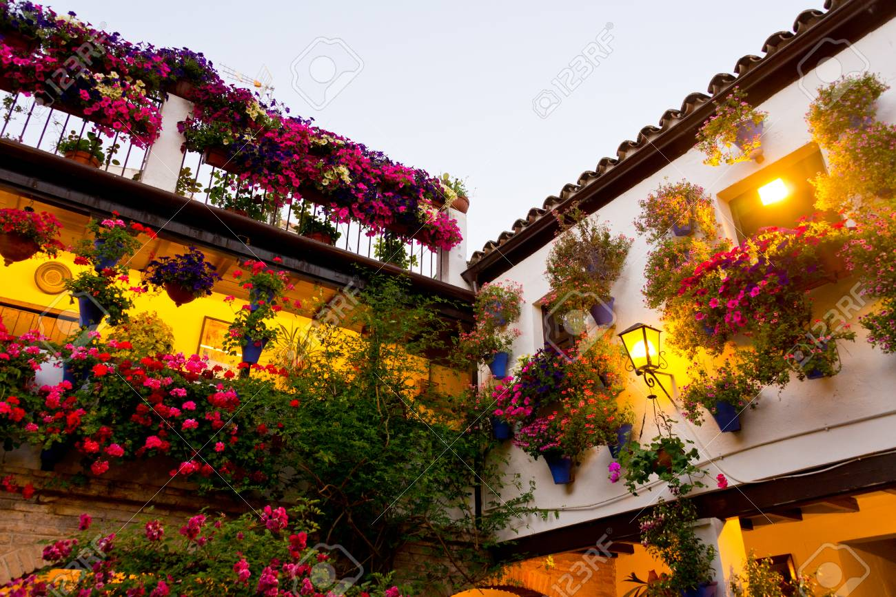 Traditional Flower-decorated Patio In Cordoba, Spain, Duriing ...