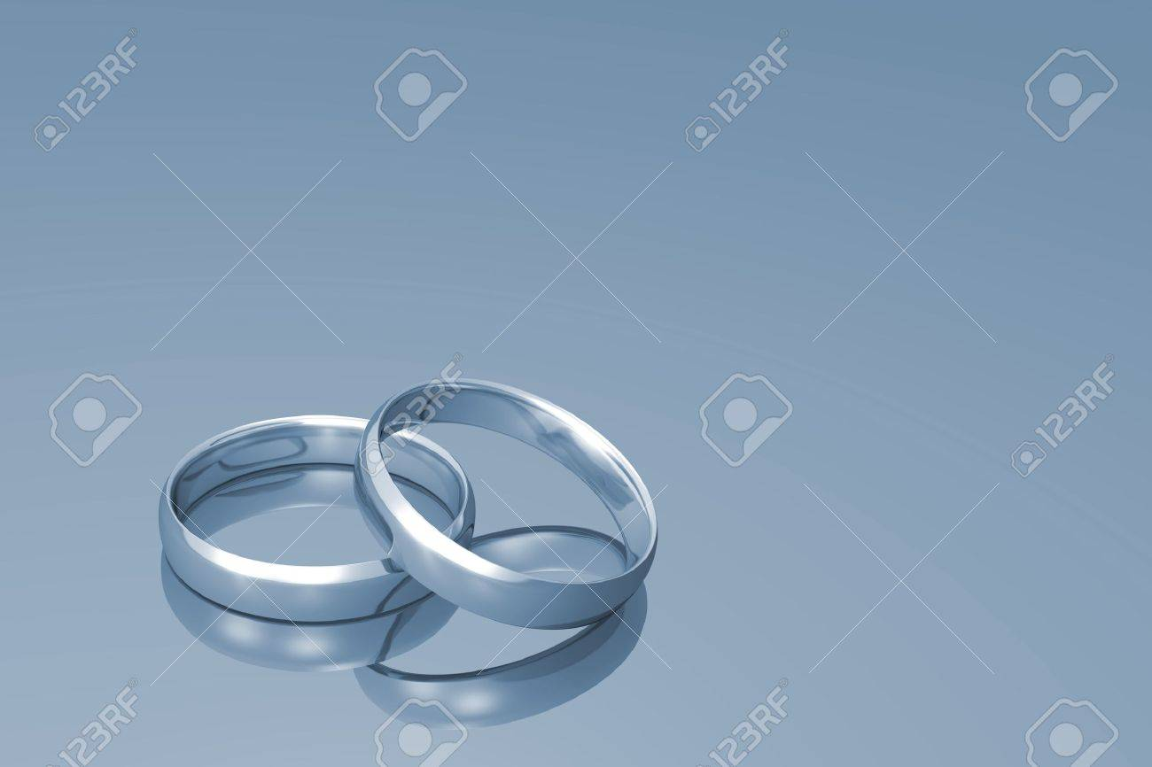Silver wedding bands on a grey background. Stock Photo - 8490565