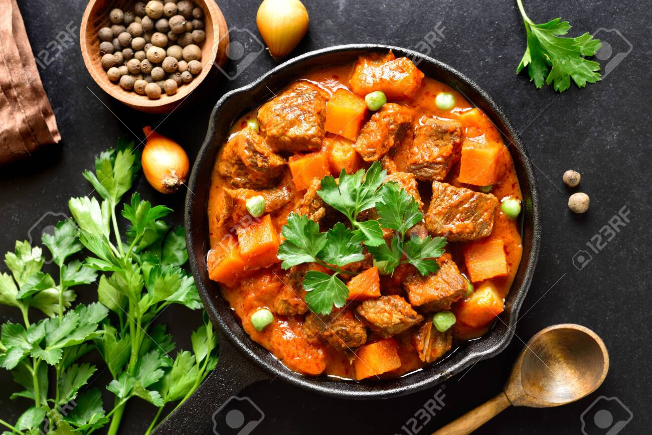 Beef Stew With Potatoes In Tomato Sauce On Black Stone Background Stock Photo Picture And Royalty Free Image Image 152490159