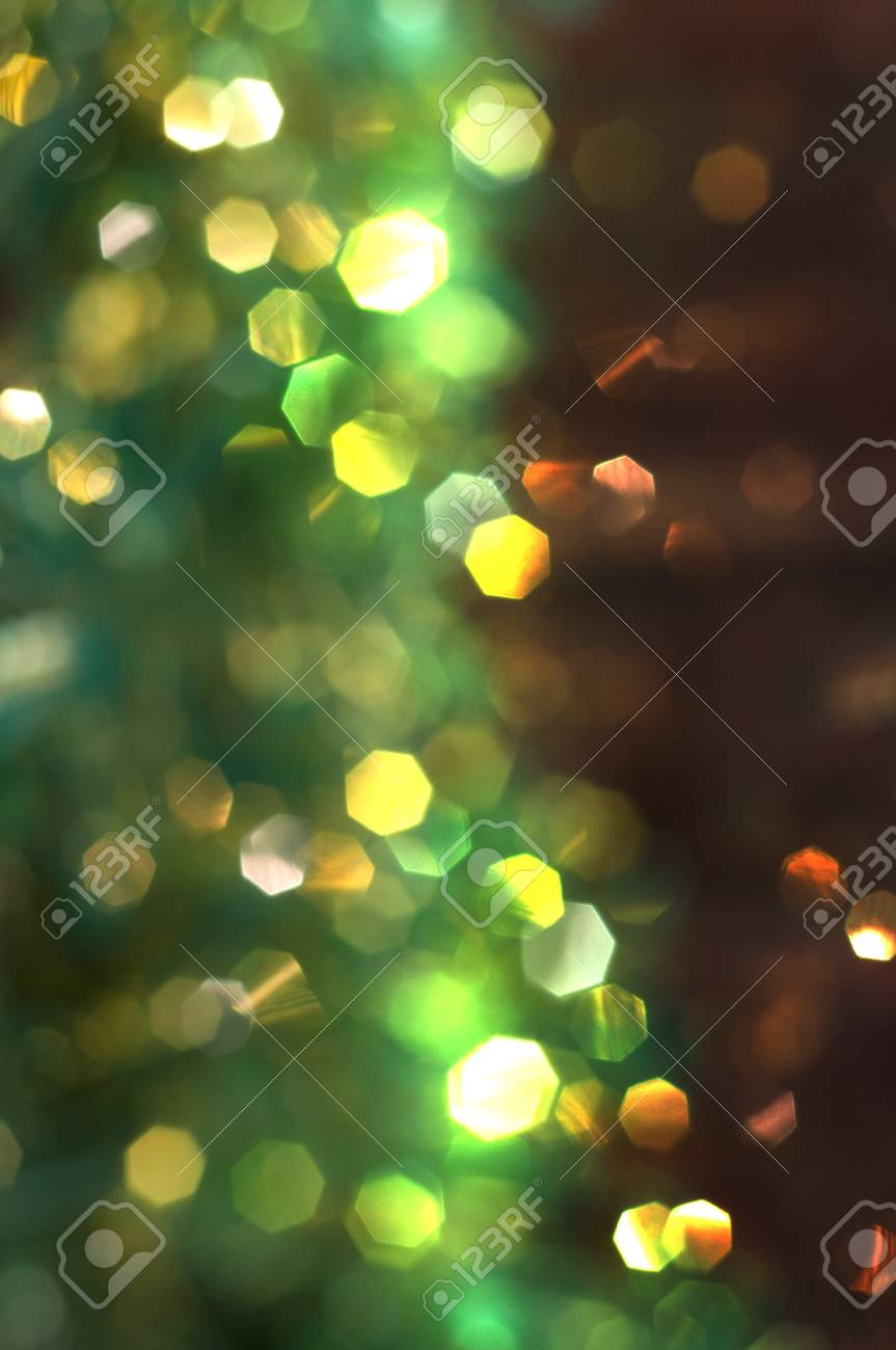 Christmas Background With Green And Yellow Bokeh Vertical Composition Stock Photo
