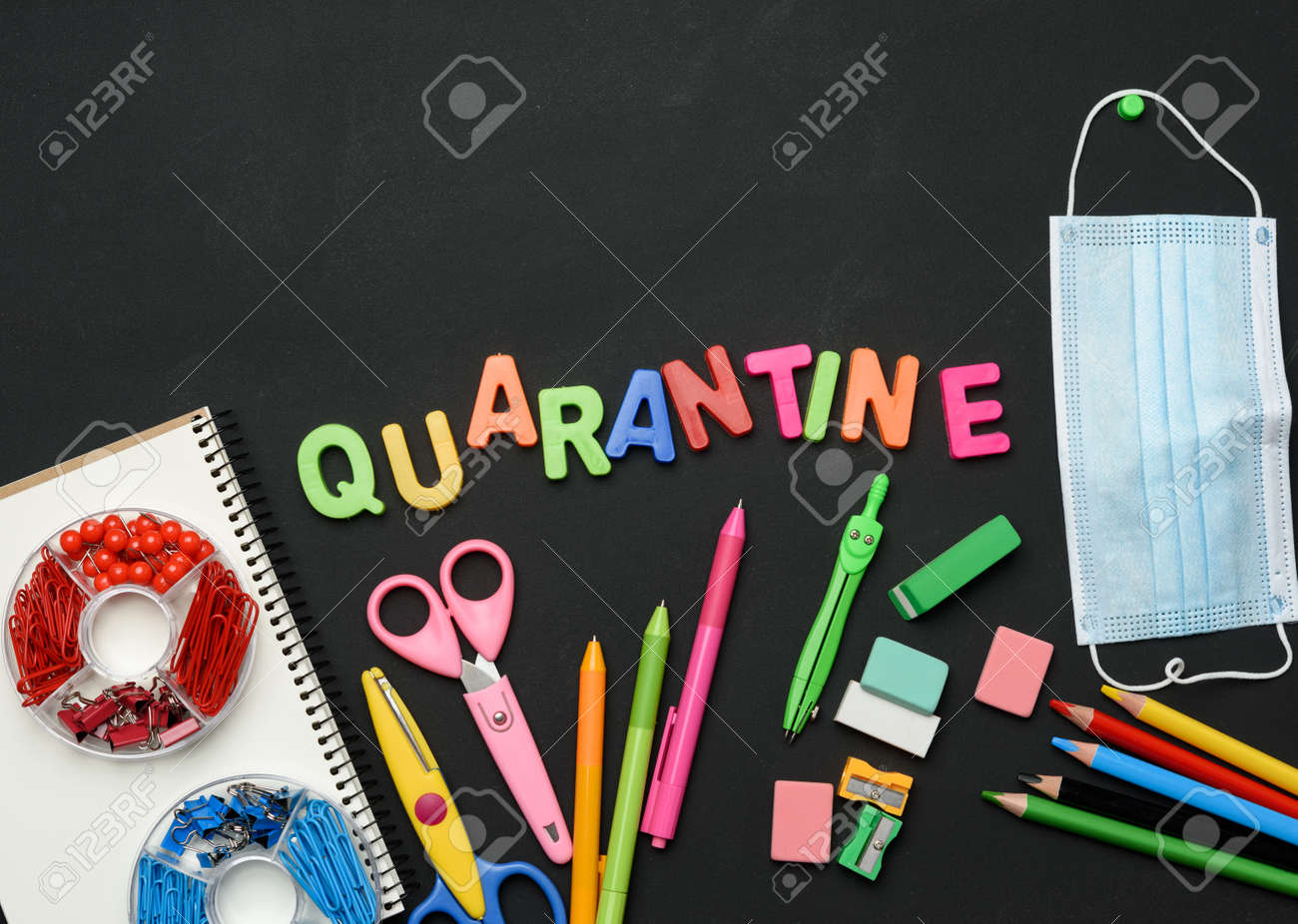 inscription quarantine from multicolored plastic letters and school supplies on black chalk board, concept of closing schools during a pandemic - 159813711