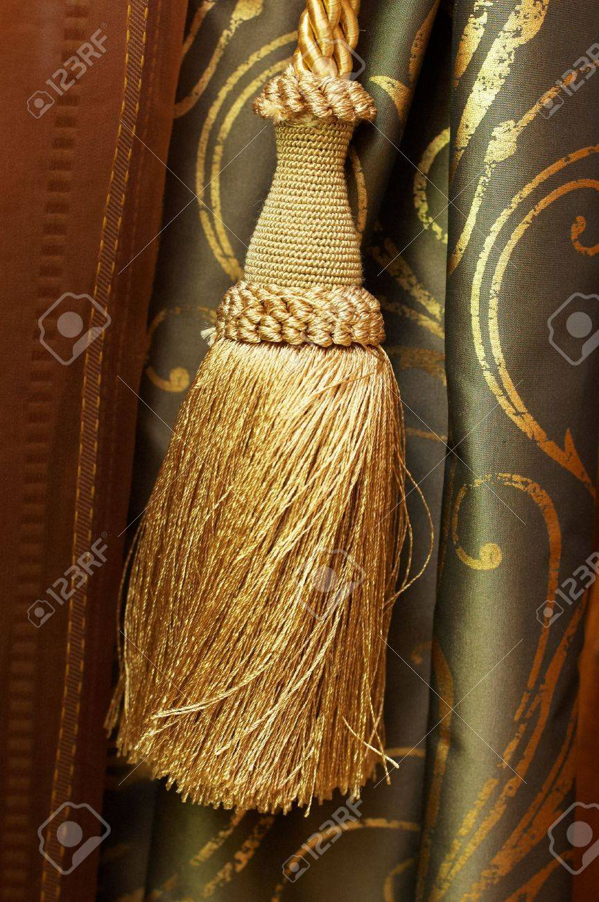 Gold  tassel  and knot on luxury cutrain Stock Photo - 4754251