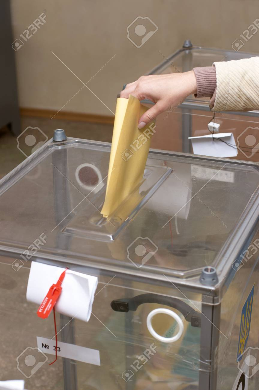 Election: ballot box and hand putting a ballot inside, elections concept, voting concept Stock Photo - 8419427