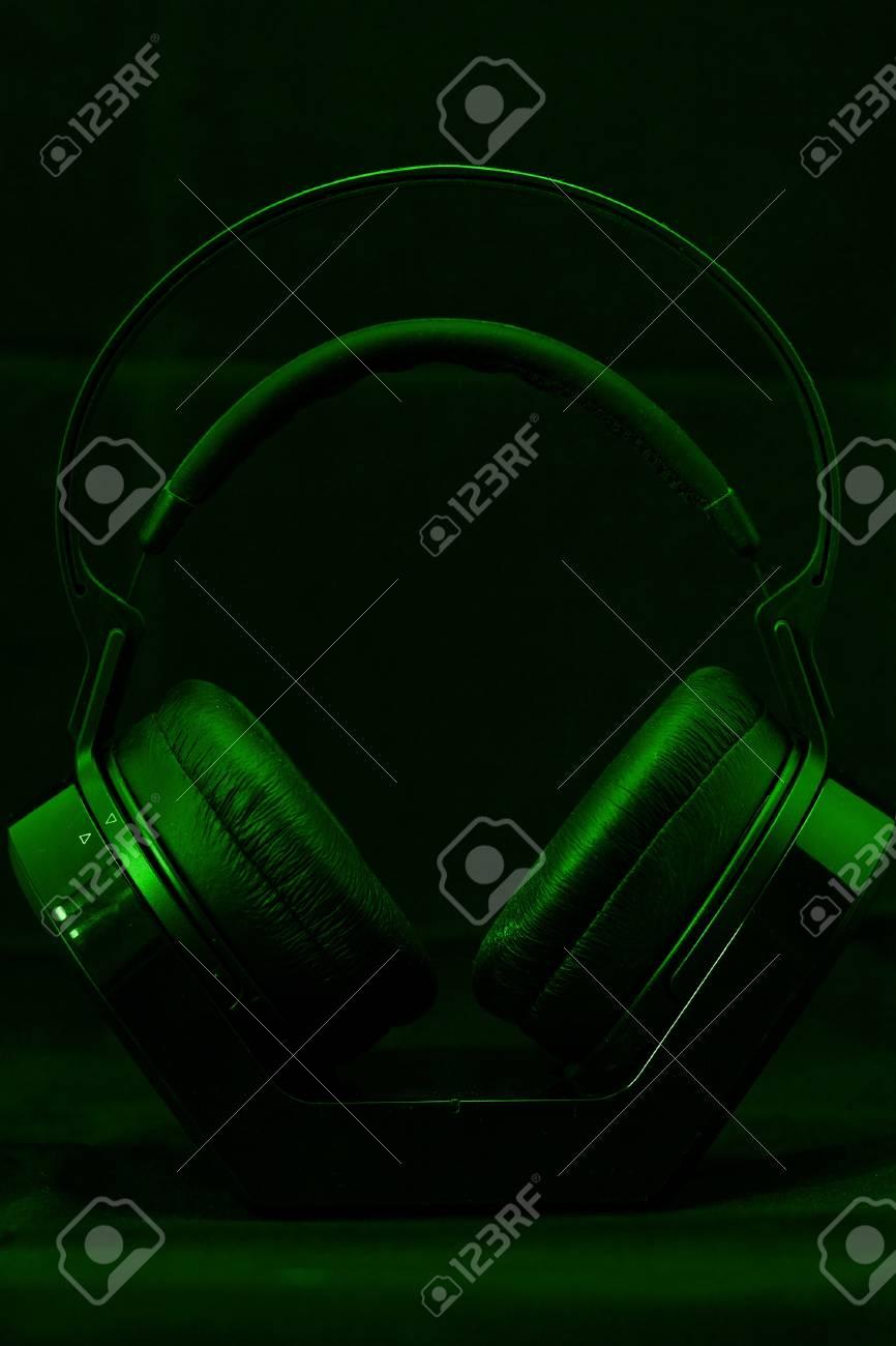 Black modern Headphones on a green background Stock Photo - 21361093
