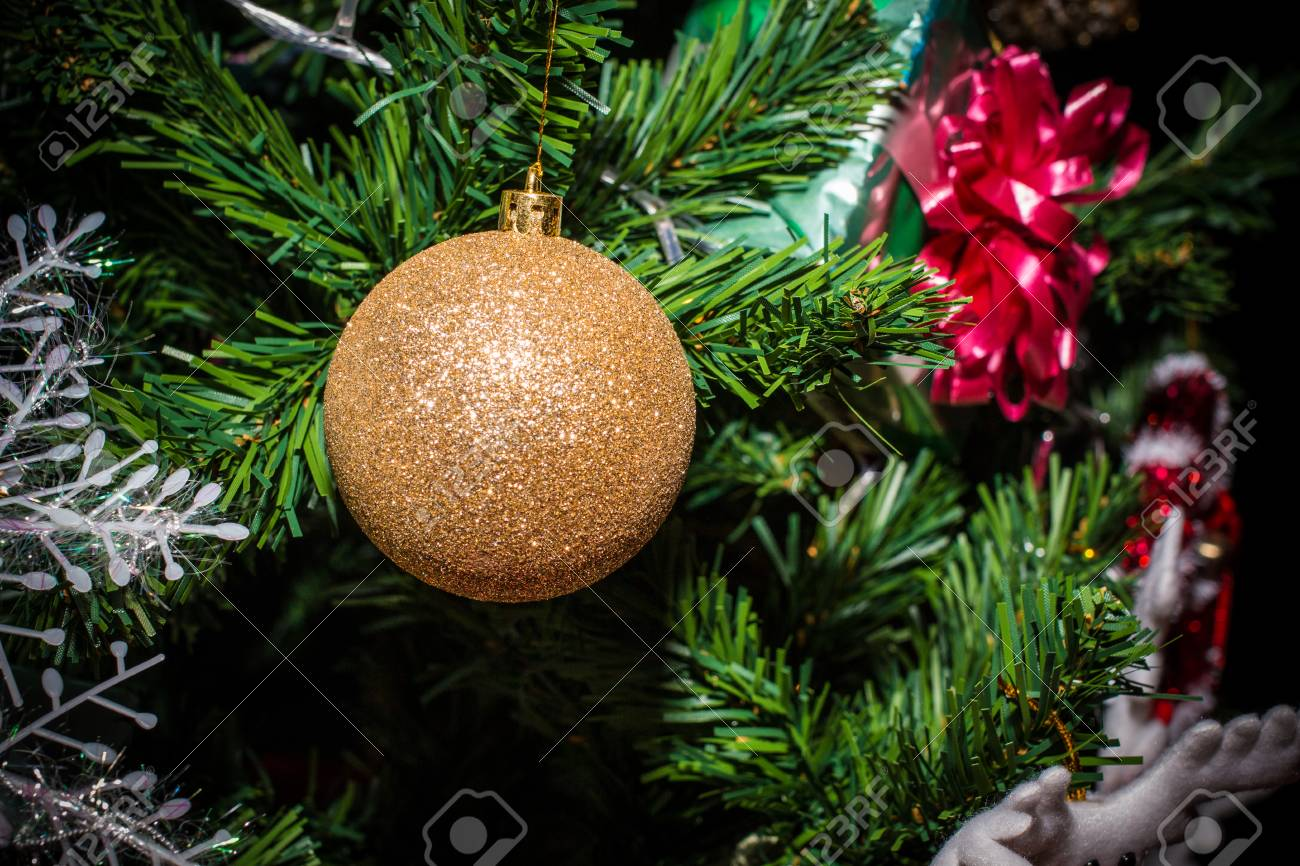 Closeup Of Christmas Decorations Gifts On Tree For New Year Background