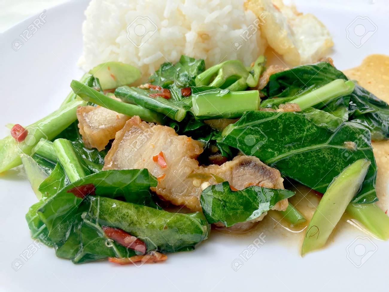 Stir fry Kai Land and crispy pork, stir fried rice with rice