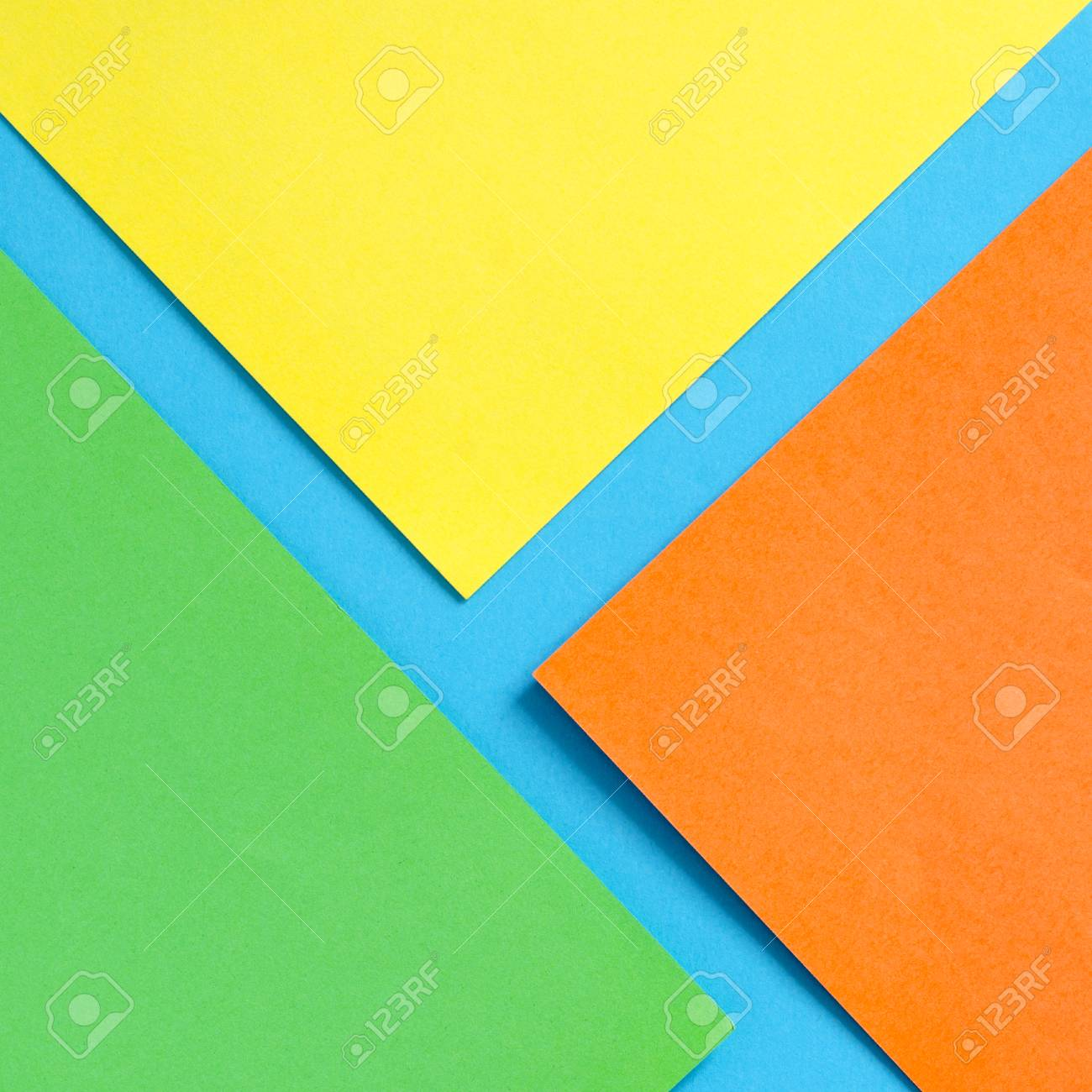 Blue Green Orange And Yellow Sheets Of Paper Abstract Background