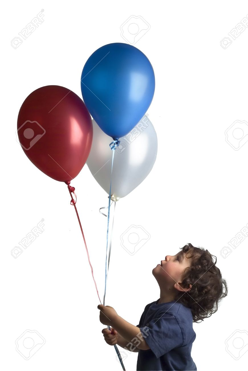 little boy holding red blue and white balloons Stock Photo - 2733547