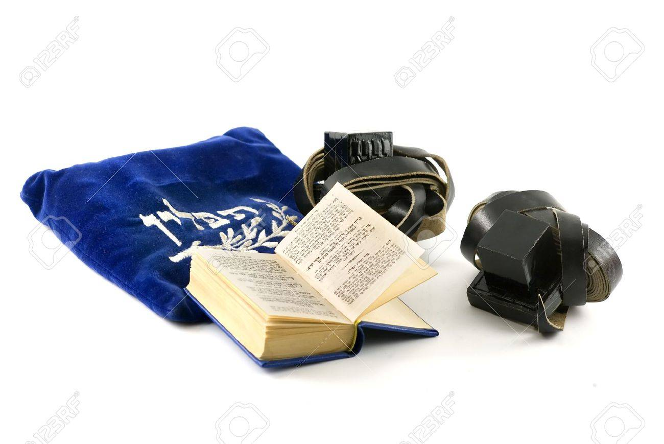 Tefillin - phylacteries worn by Jewish men for morning prayers, Siddur - Jewish prayerbook and bag isolated on white Stock Photo - 2897354