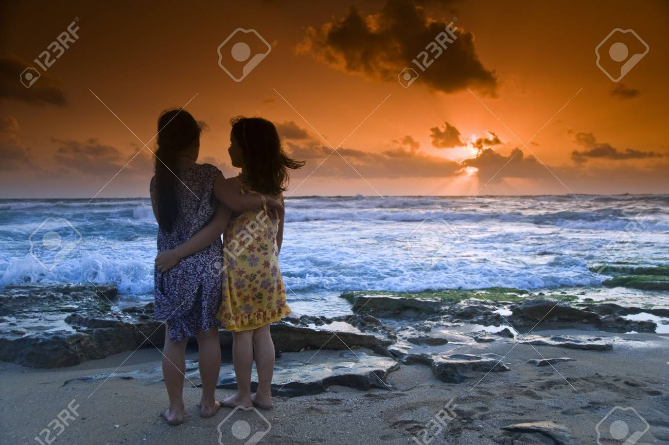 two girls in the beach at sunset Stock Photo - 3159801