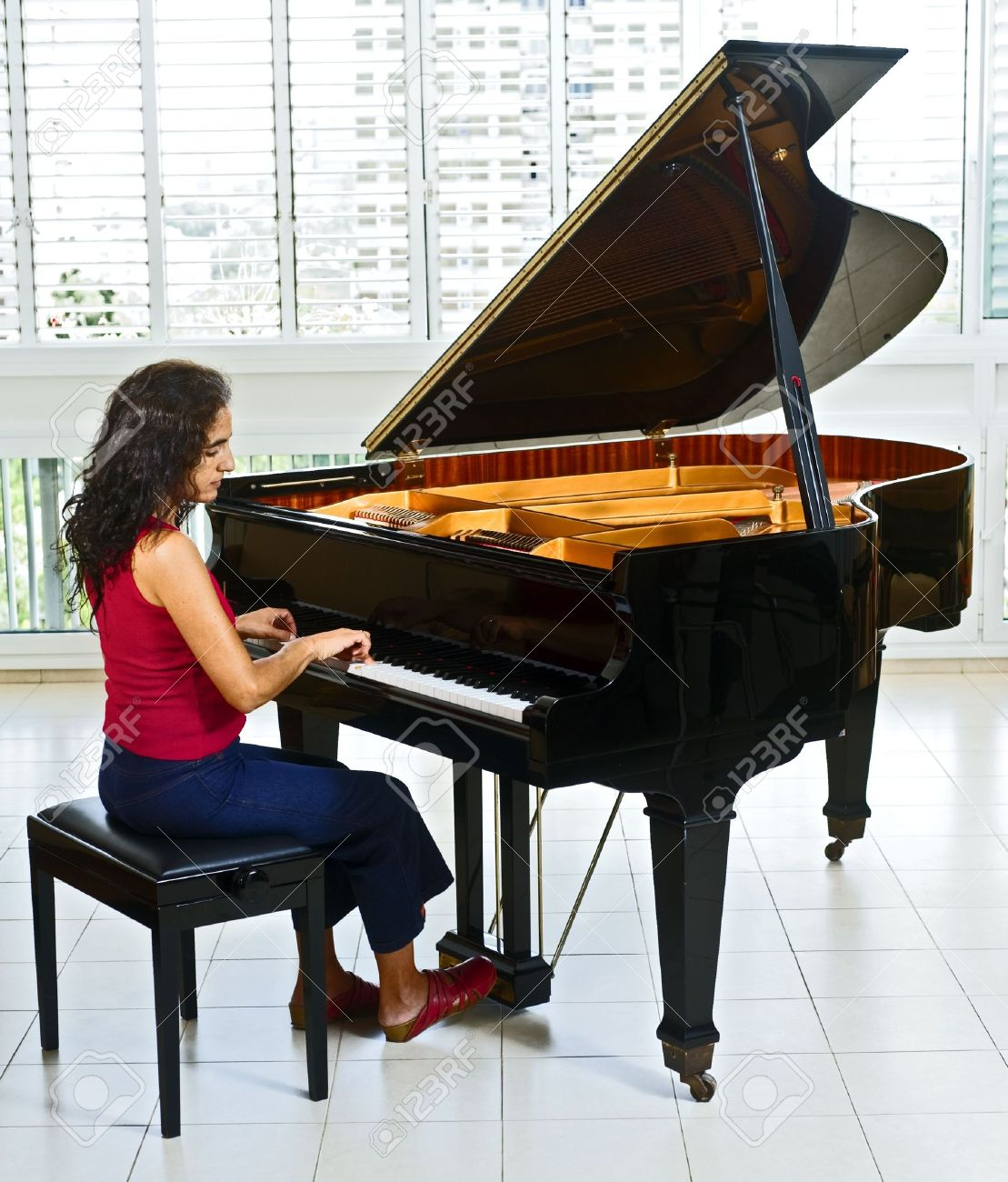 Women Pianist Playing On A Grand Piano Stock Photo, Picture And ...