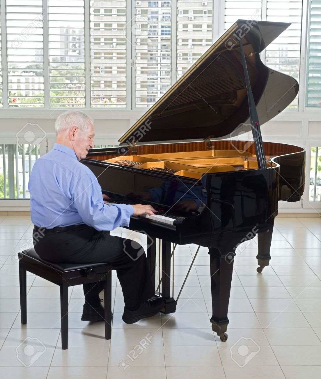 Senior Man Playing On A Grand Piano At Home Stock Photo, Picture And ...