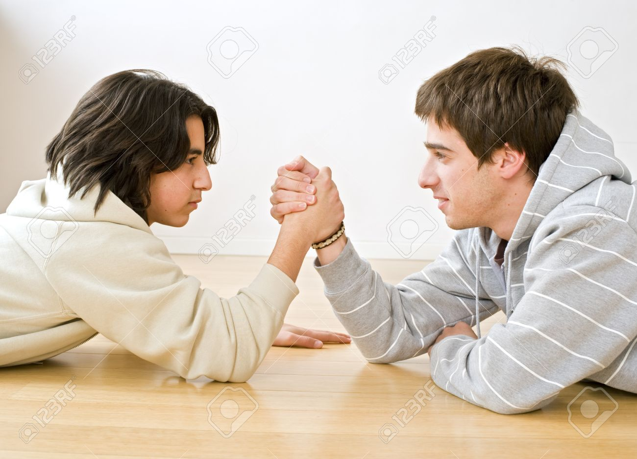 two brothers arm wrestling on the floor Stock Photo - 4003054