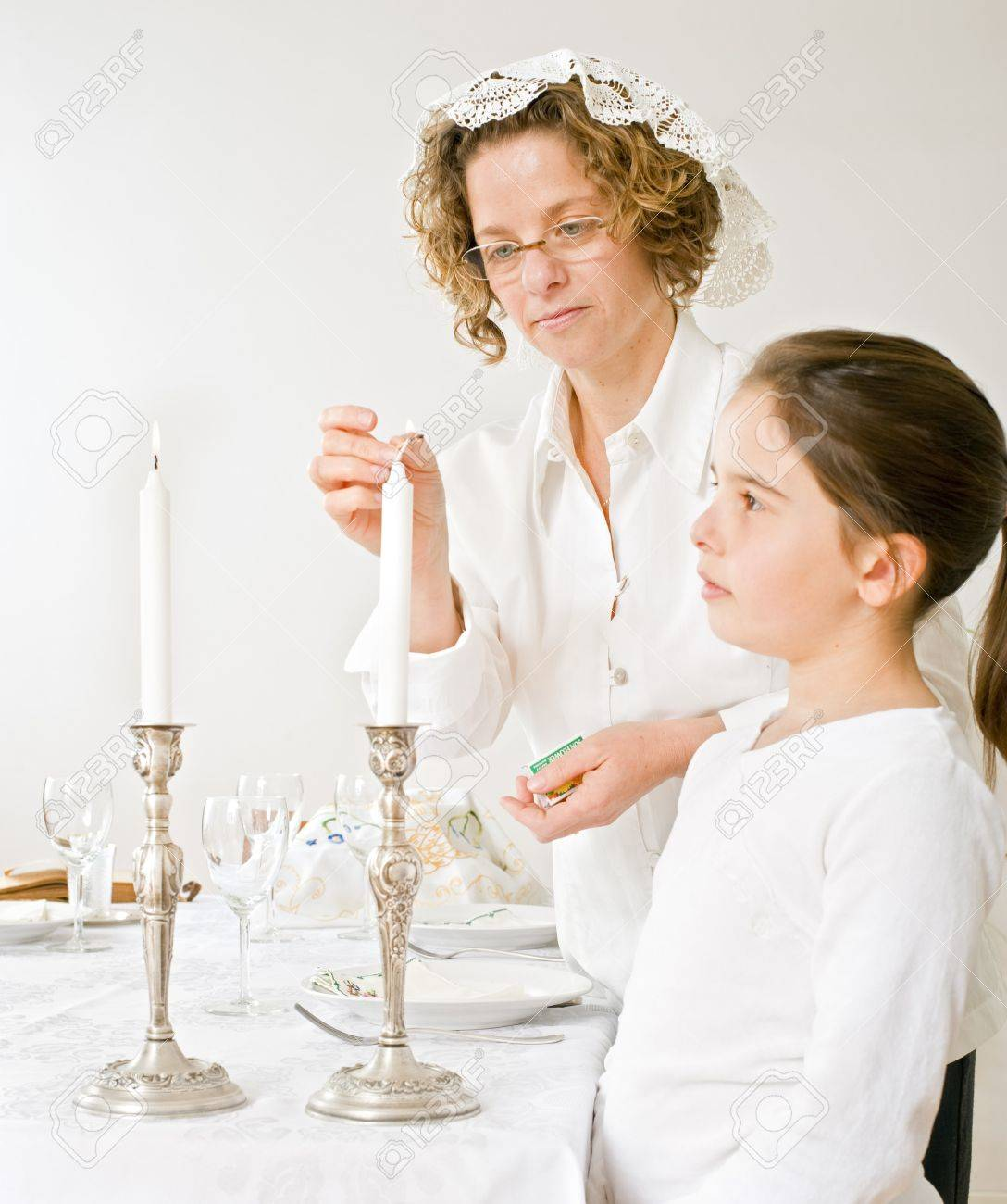 mother and daughter with shabbat candels Stock Photo - 4037871