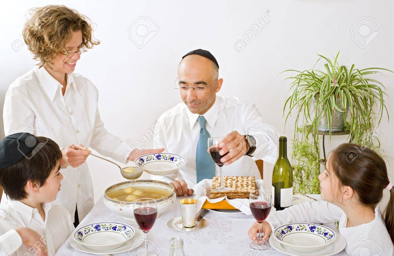 father mother son and daughter in seder celebrating passover Stock Photo - 4037877