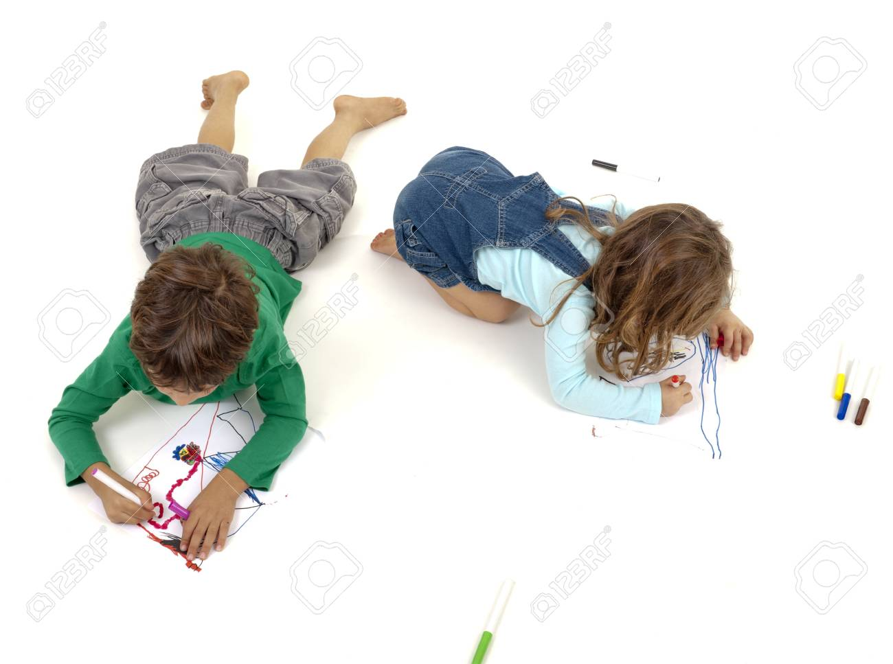 boy and girl painting isolated on white Stock Photo - 7955559