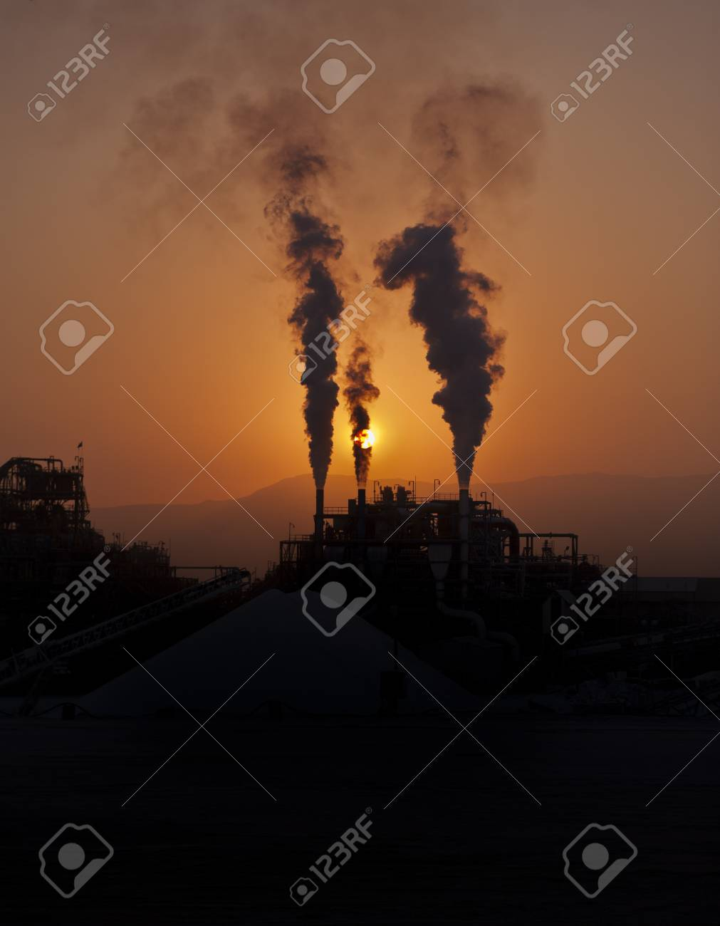 Industry blowing fumes into the air Stock Photo - 8357493