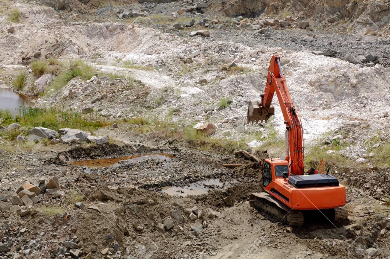 Excavator standing in sandpit with risen bucket Stock Photo - 7388948