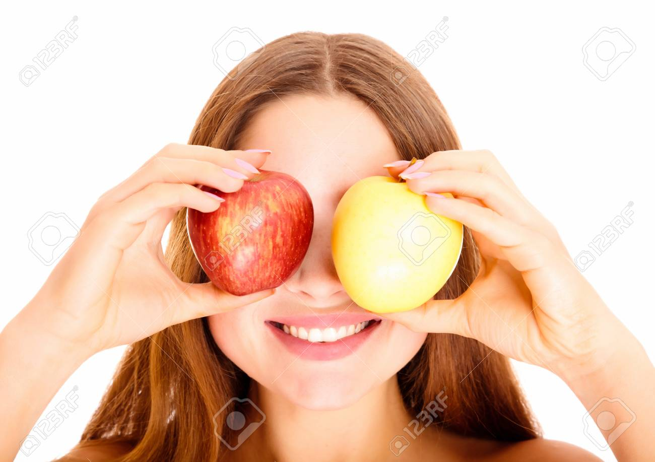 Portrait of attractive young caucasian woman with the apples against white background. Stock Photo - 8025794