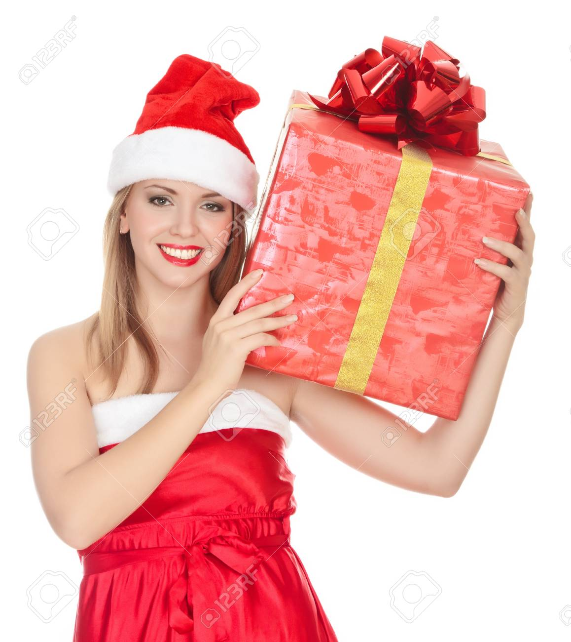 Cheerful santa helper girl with big gift box on her shoulder. Isolated over a white background. Stock Photo - 8329460