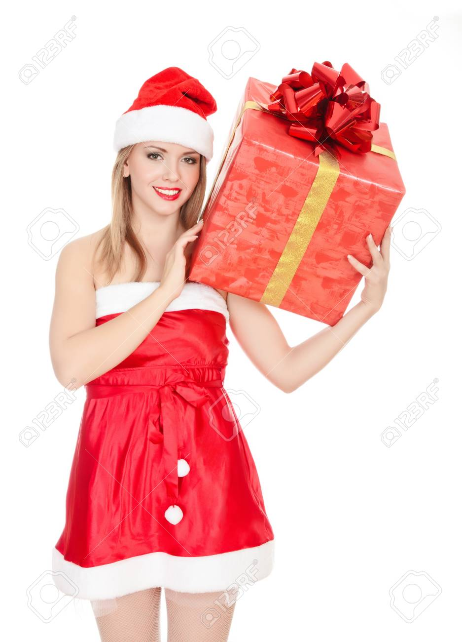 Cheerful santa helper girl with big gift box on her shoulder. Isolated over a white background. Stock Photo - 8329468