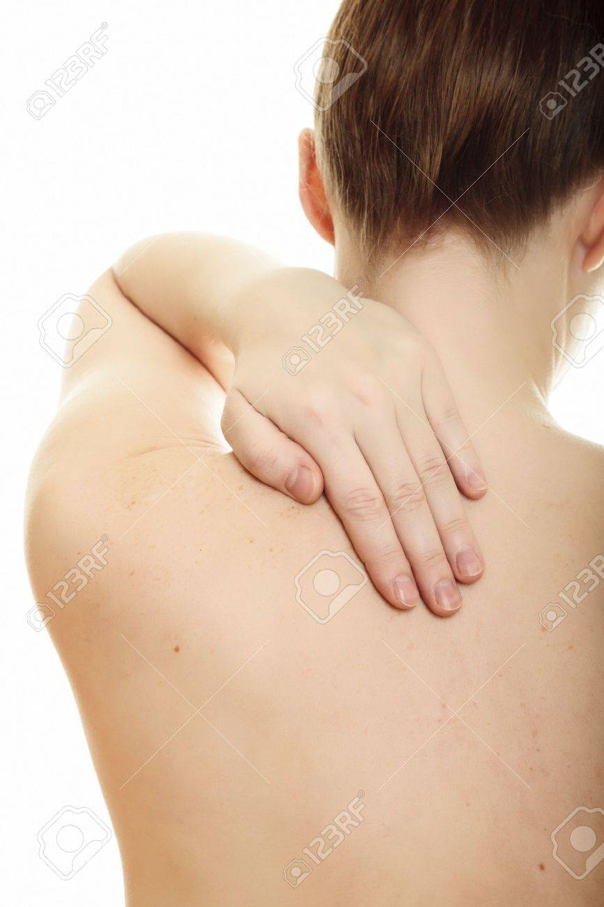 Woman from behind, naked body, holds her neck on the left side. Isolated over a white background. Stock Photo - 8418693
