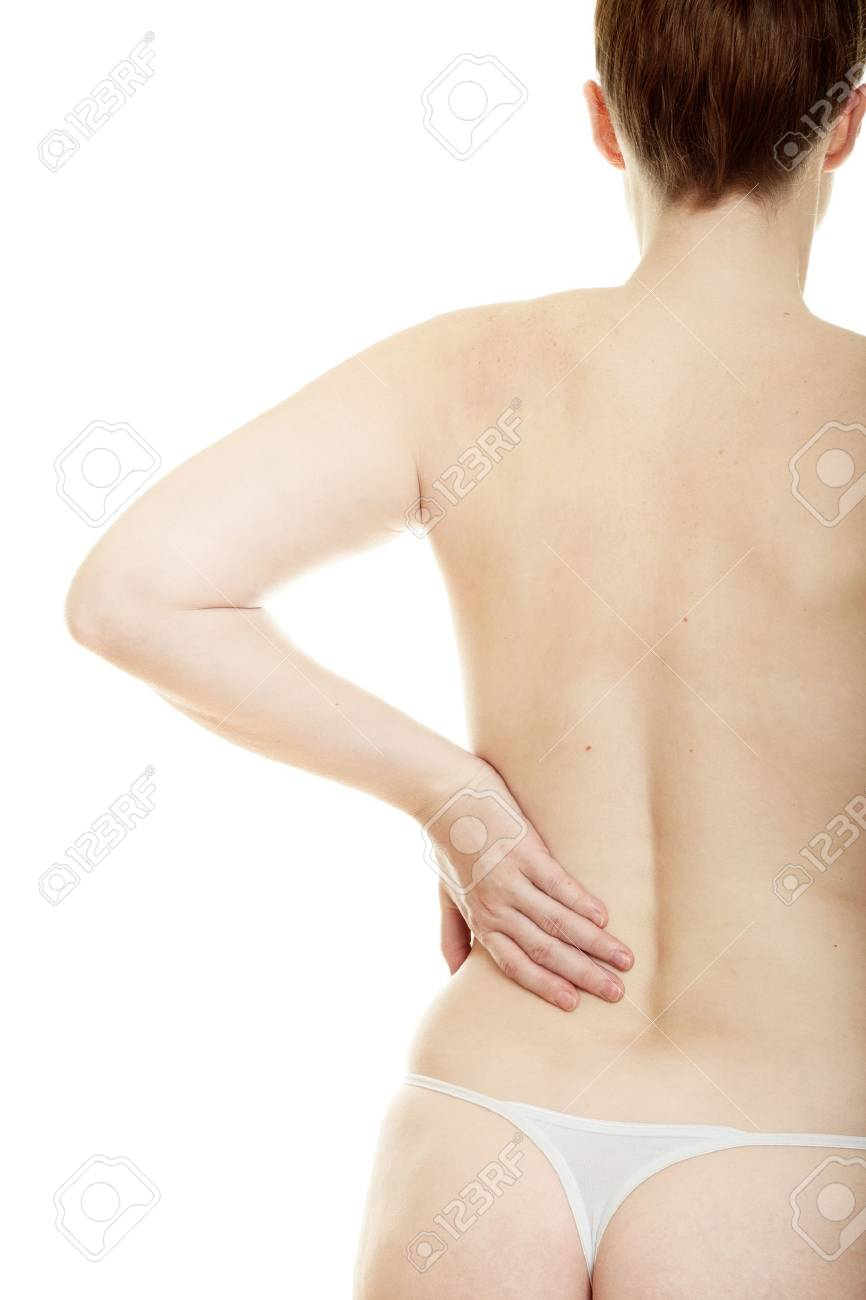 Woman massaging pain back isolated over a white background Stock Photo - 8660822