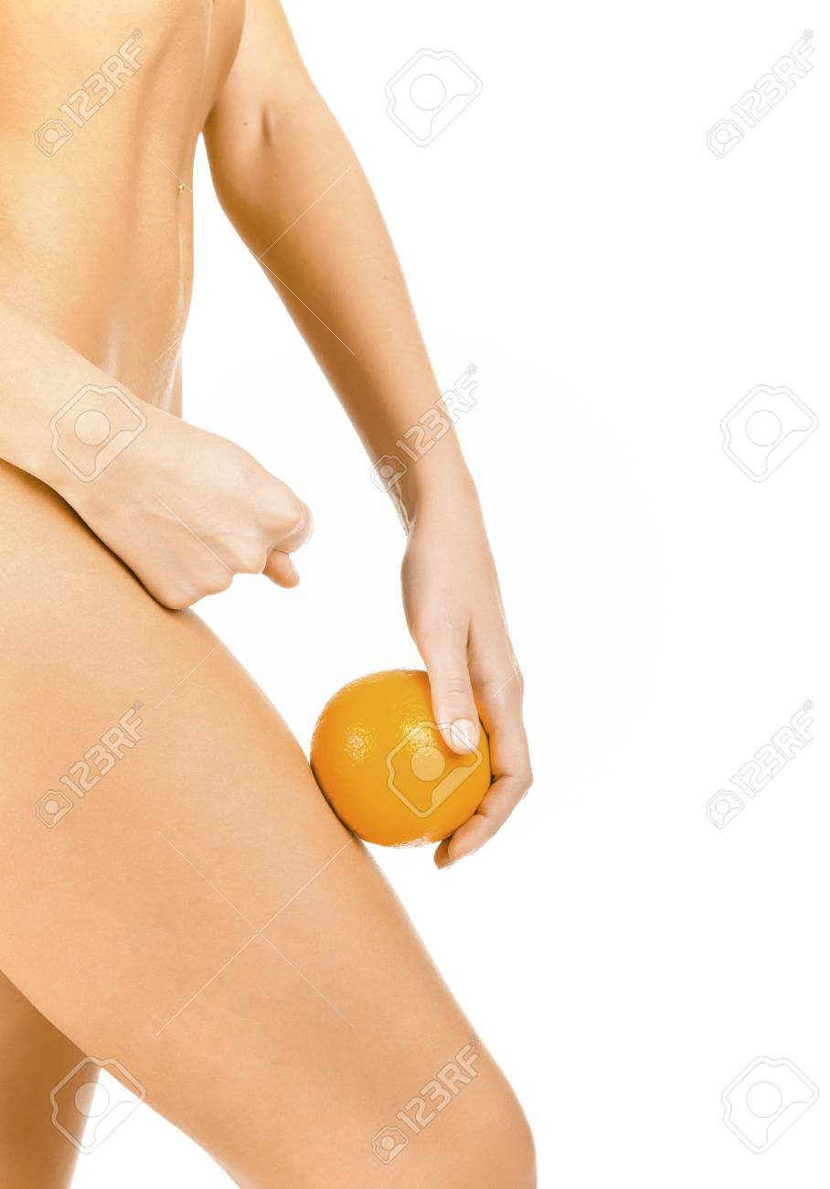 Slim woman shows the fig to cellulite, isolated on white background Stock Photo - 9032538