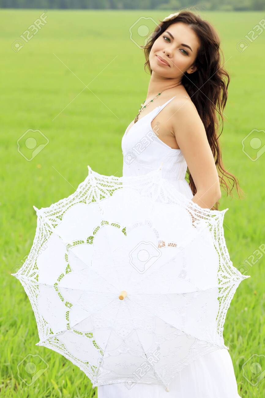young beautiful woman with white umbrella Stock Photo - 9701538