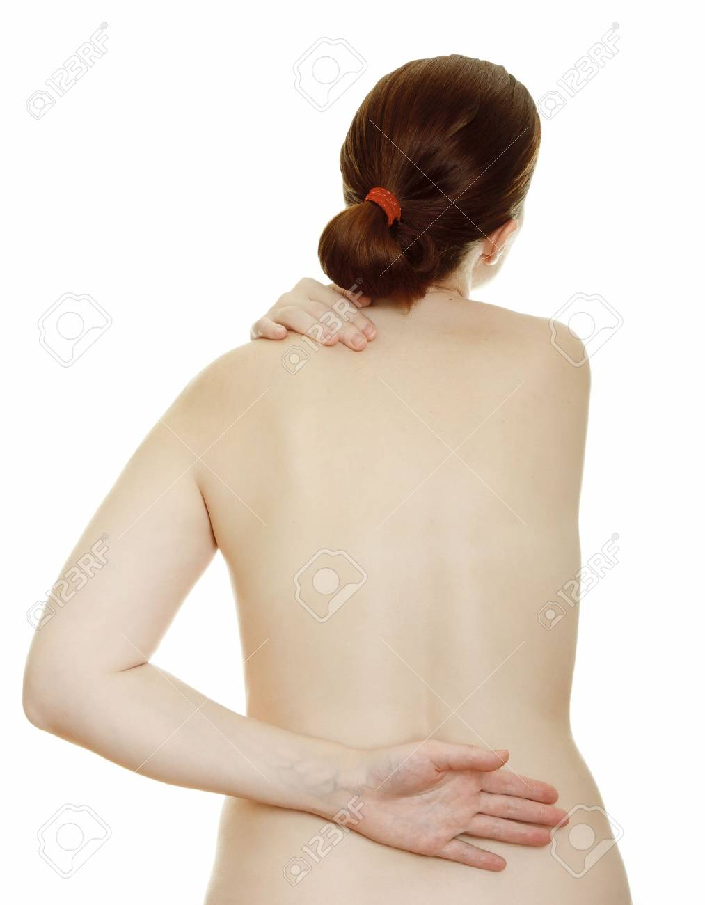 Osteochondrosis - woman massaging pain back, isolated over a white background. Stock Photo - 9742022