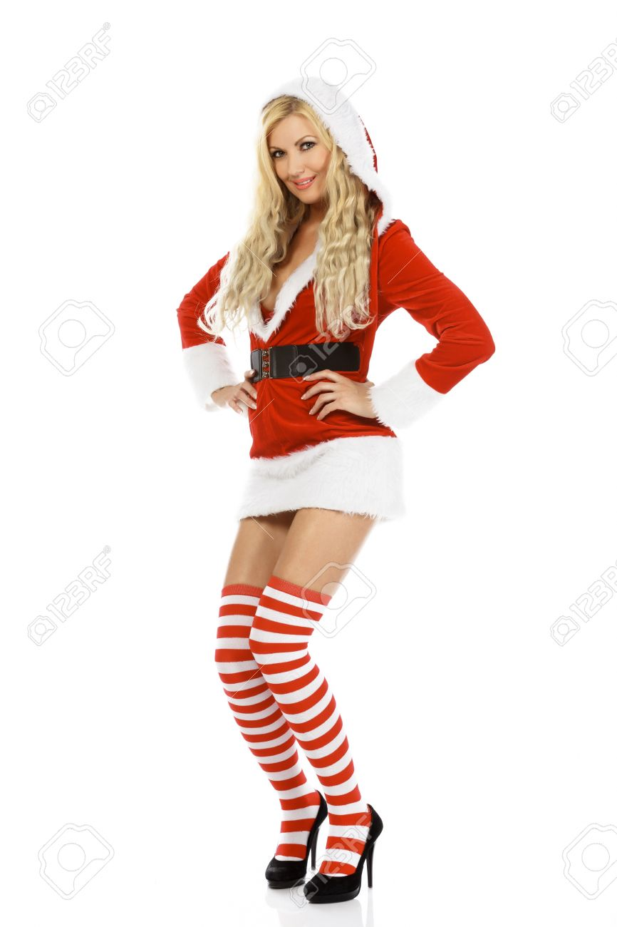 Beautiful and sexy woman wearing Santa Clause costume isolated on white background. Stock Photo  sc 1 st  123RF.com & Beautiful And Sexy Woman Wearing Santa Clause Costume Isolated ...