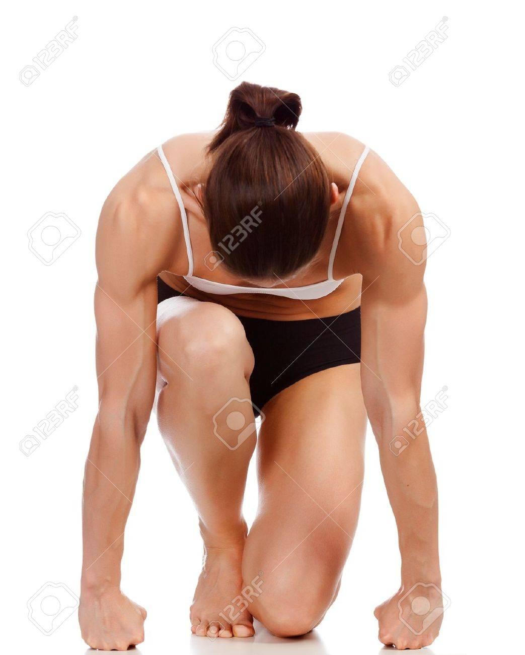 Female fitness bodybuilder posing against white background Stock Photo - 12499076