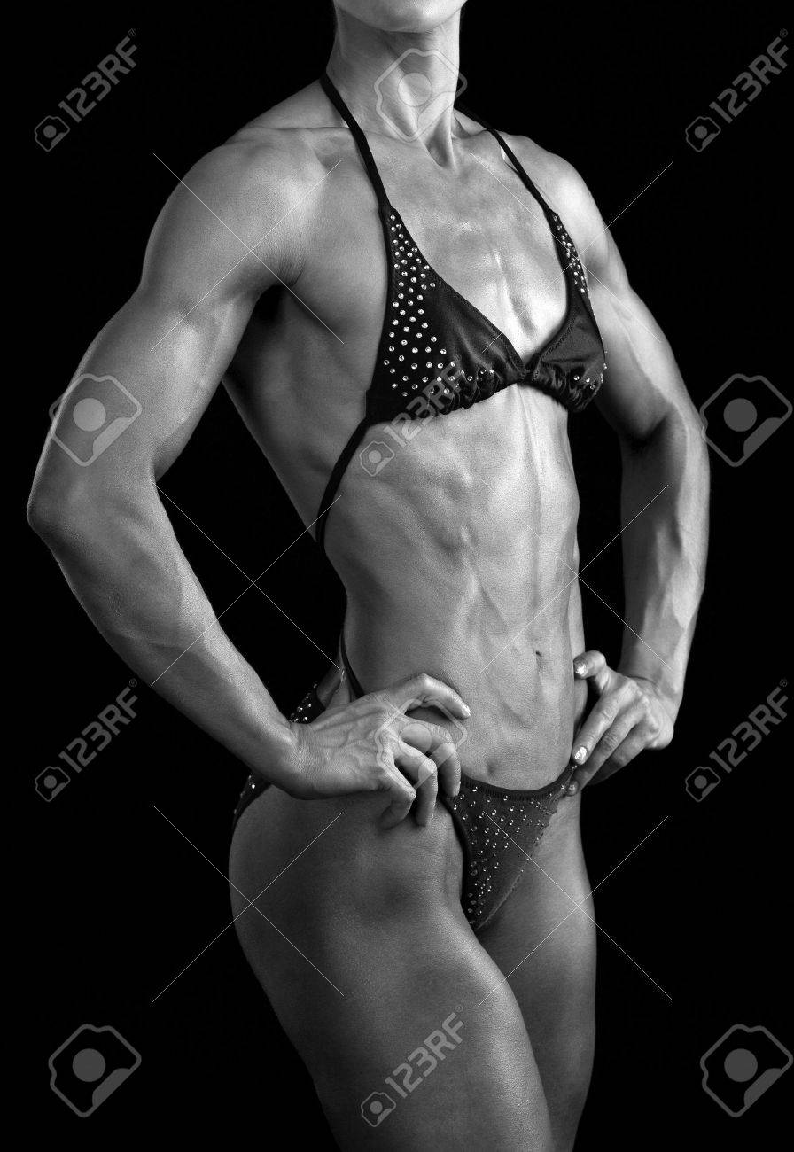 Black and white image of a muscular female body against black background. Stock Photo - 13321188