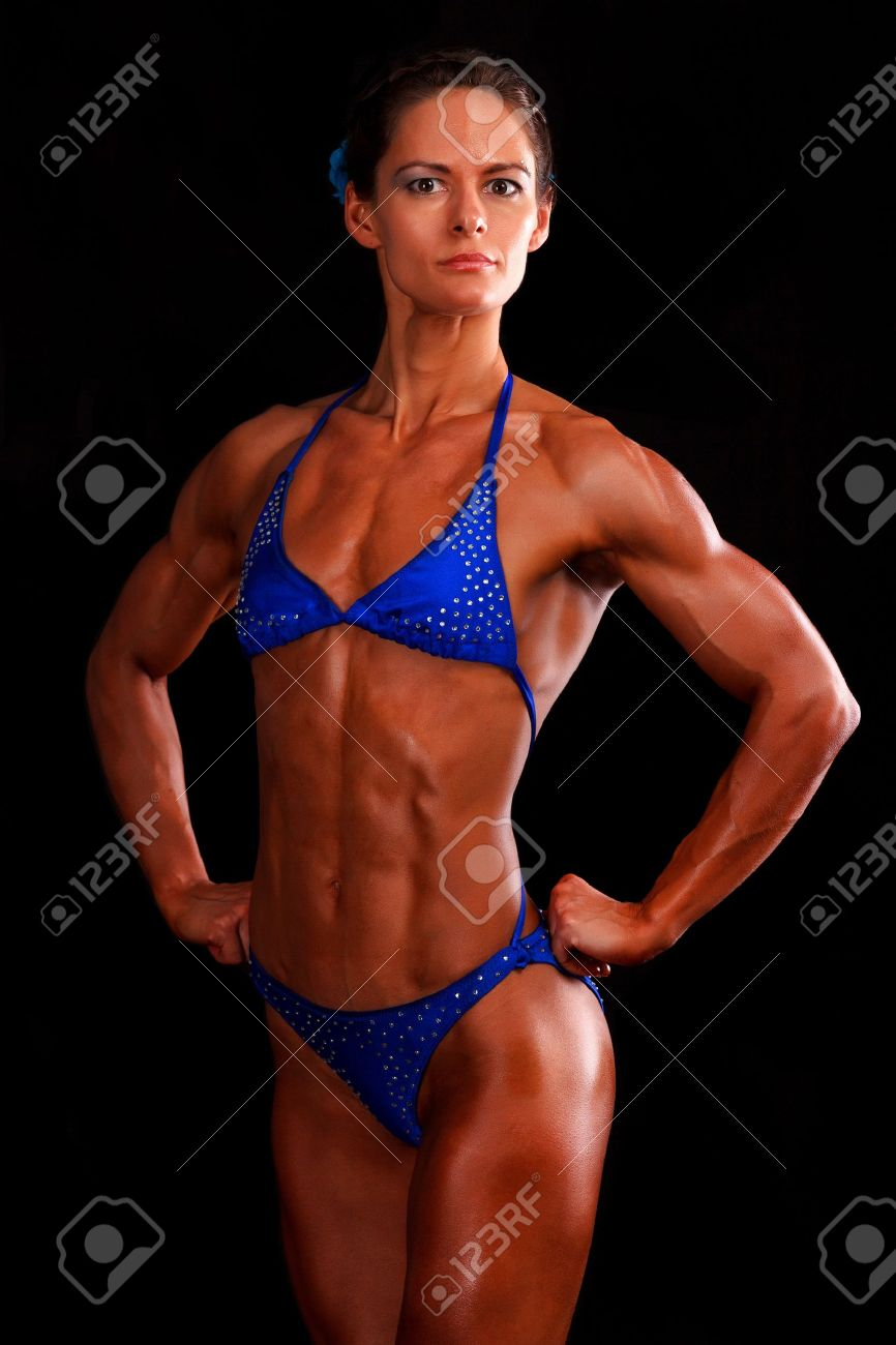 muscular woman posing against black background. Stock Photo - 13321130