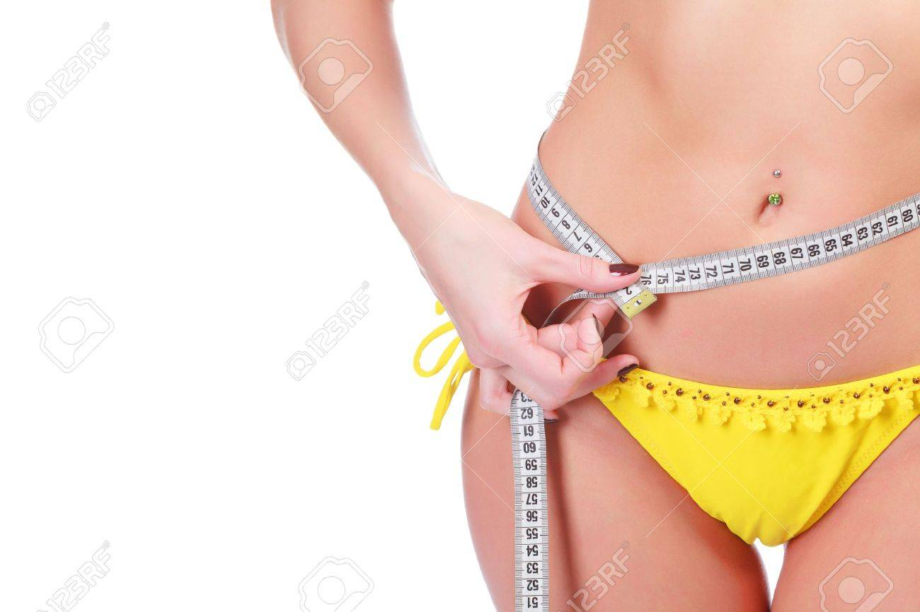 Slim waist with a tape measure around it, isolated on white background Stock Photo - 13523803