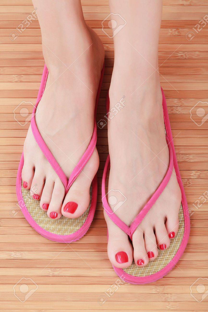 58b4653cc14cac Female feet with flip-flops Stock Photo - 14258466