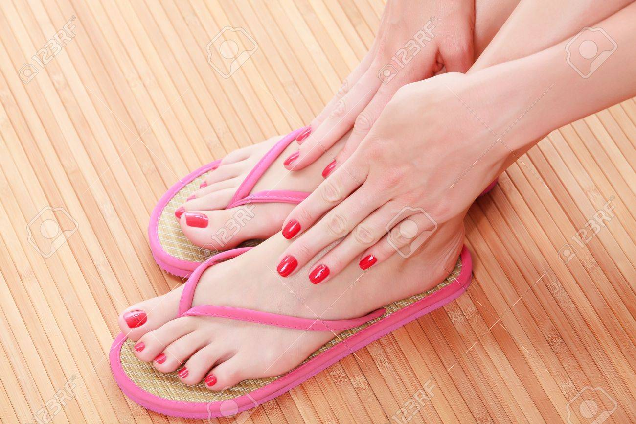 f37492a466bbb7 Female feet with flip-flops Stock Photo - 14655292