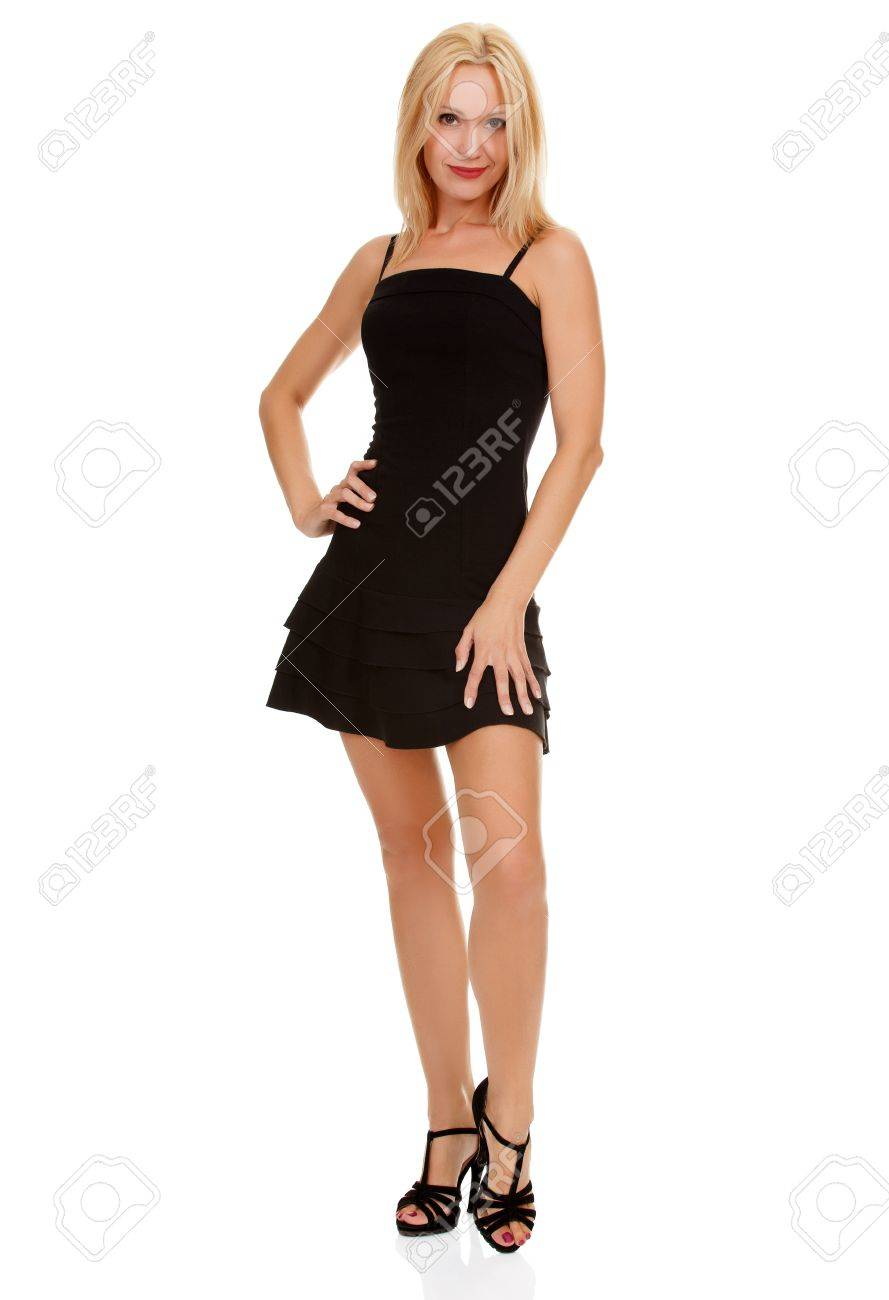 Sexy blond lady in small black dress isolated on white Stock Photo -  15645150 0d6ccaf158