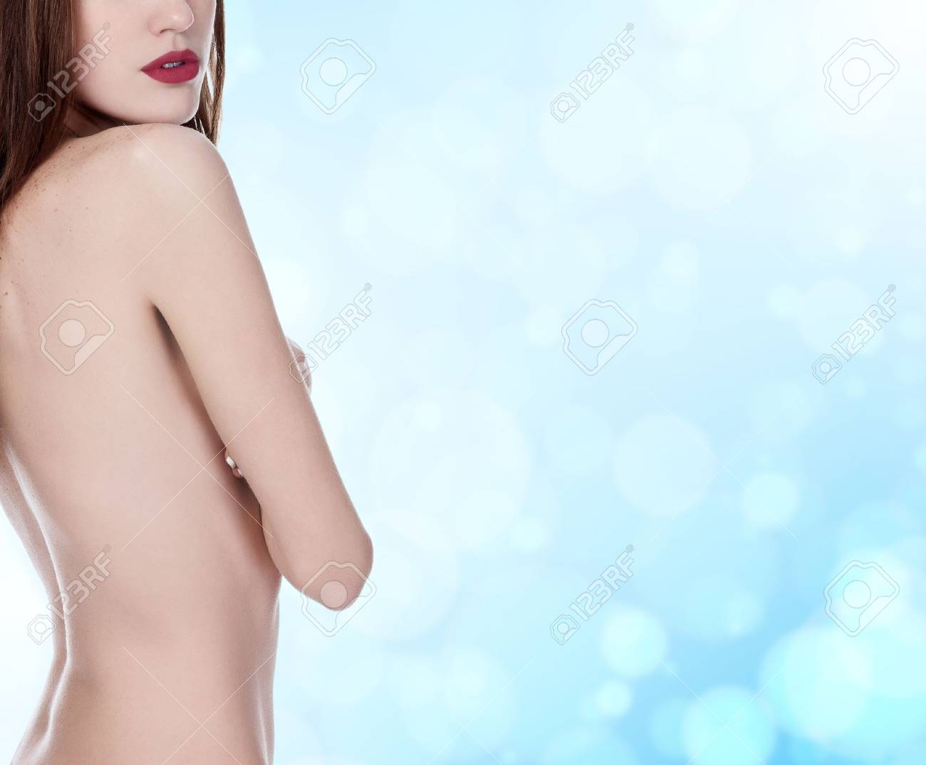 beautiful woman with long hair on blue blurred background Stock Photo - 16659809