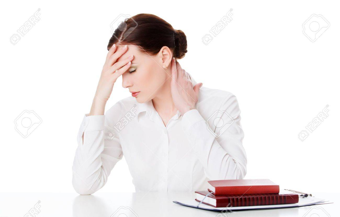 Tired young woman at a table with books, white background Stock Photo - 17862084