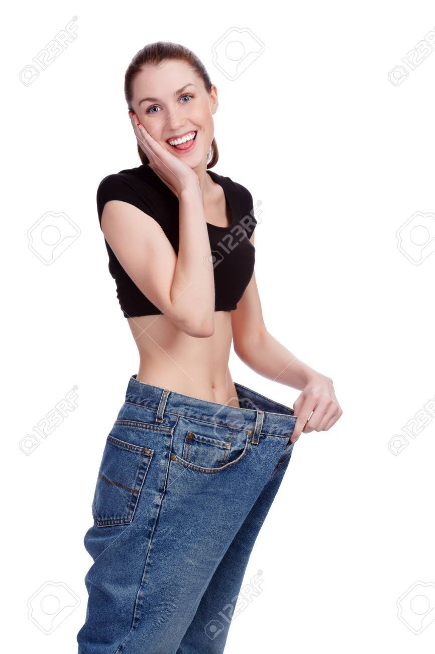 Girl in big jeans. White background Stock Photo - 18793657