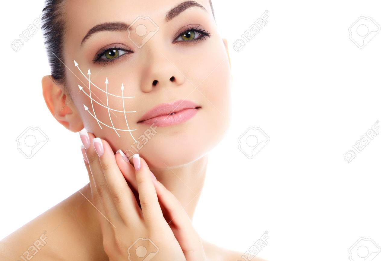 Young female with clean fresh skin, white background - 26551455