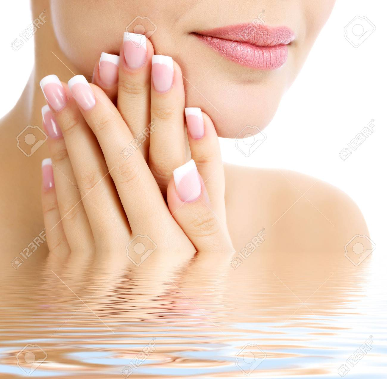 Part of female face and hands, white , copyspace - 27572501
