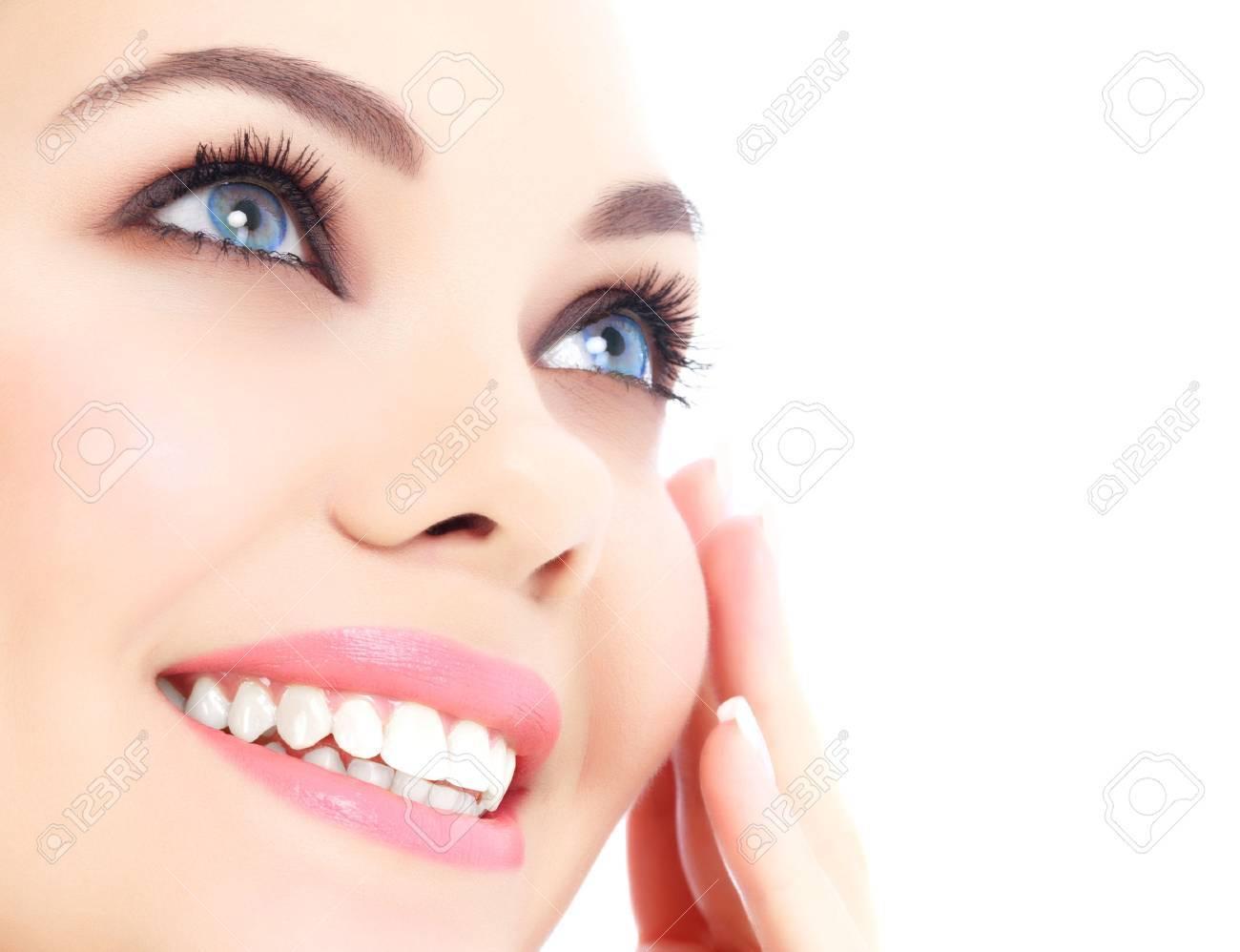 Cheerful female with fresh clear skin, white background. - 30533799