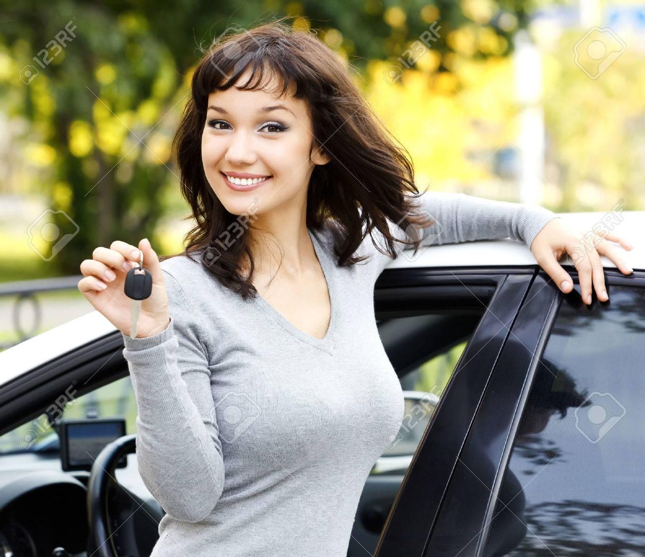 Pretty girl showing the car key - 38632370