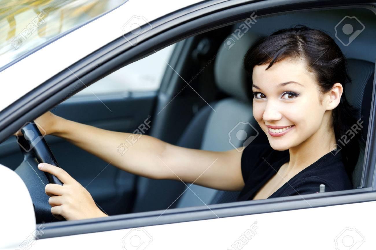 Pretty girl in a car - 39169983