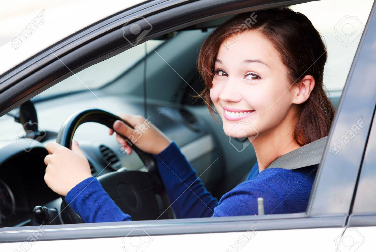 Happy female driver smiling to you - 40167689