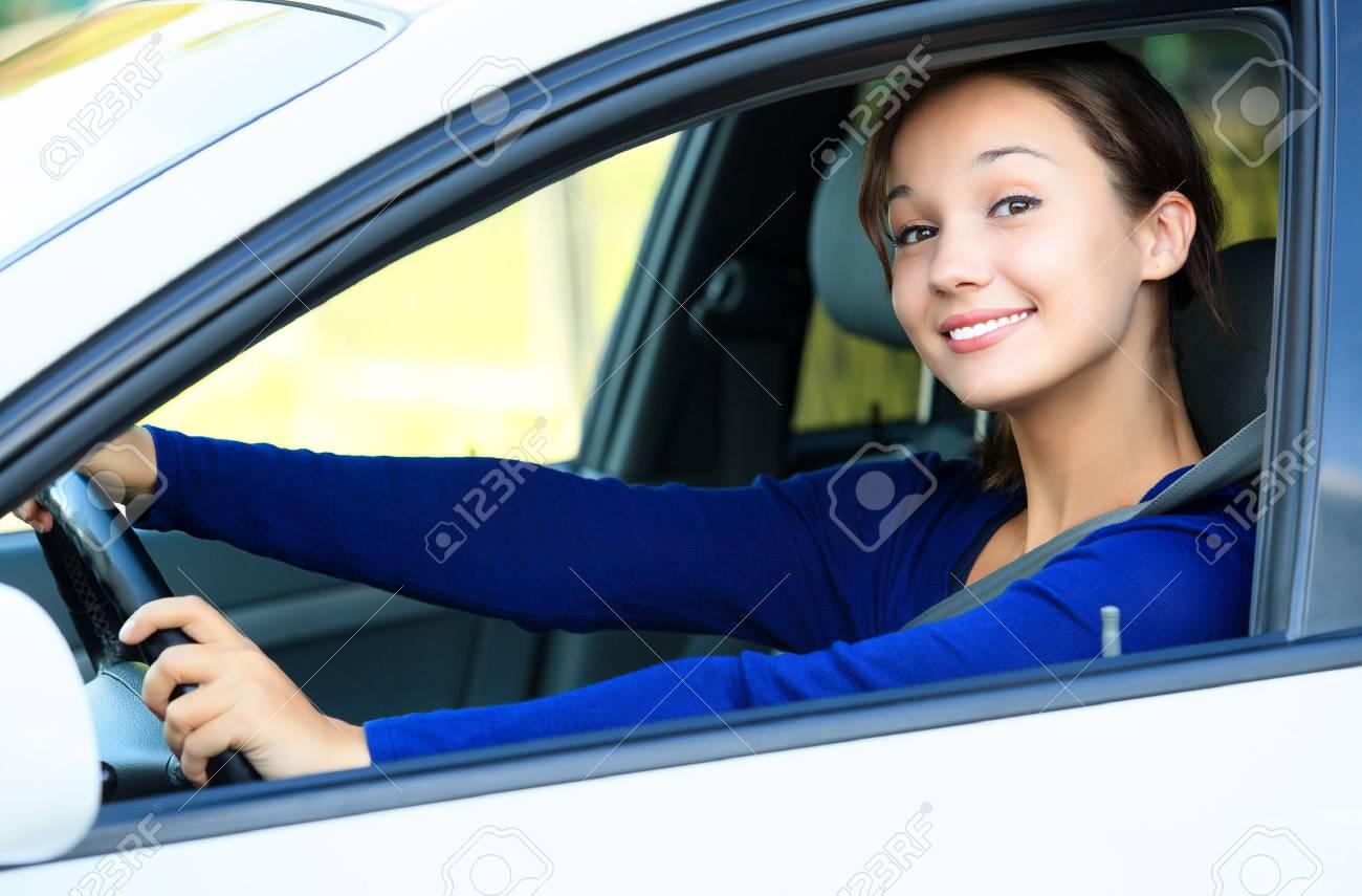 Pretty girl in a car - 40168234